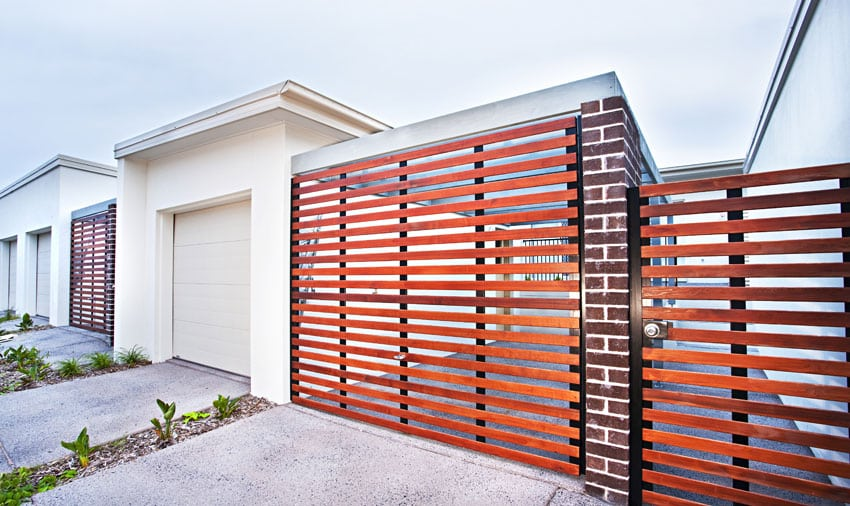 Modern horizontal fence at entry to home