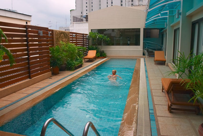 Horizontal wood slat privacy fence around swimming pool