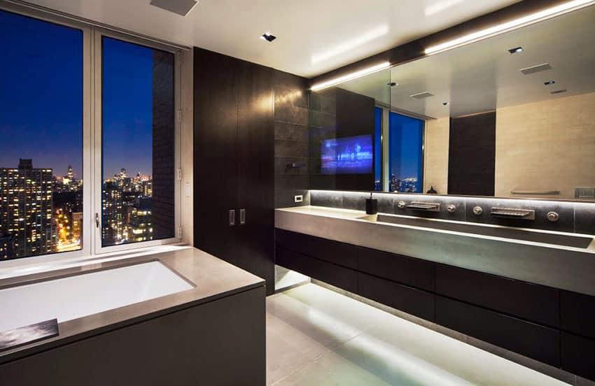 Sleek dark modern bathroom with high city views