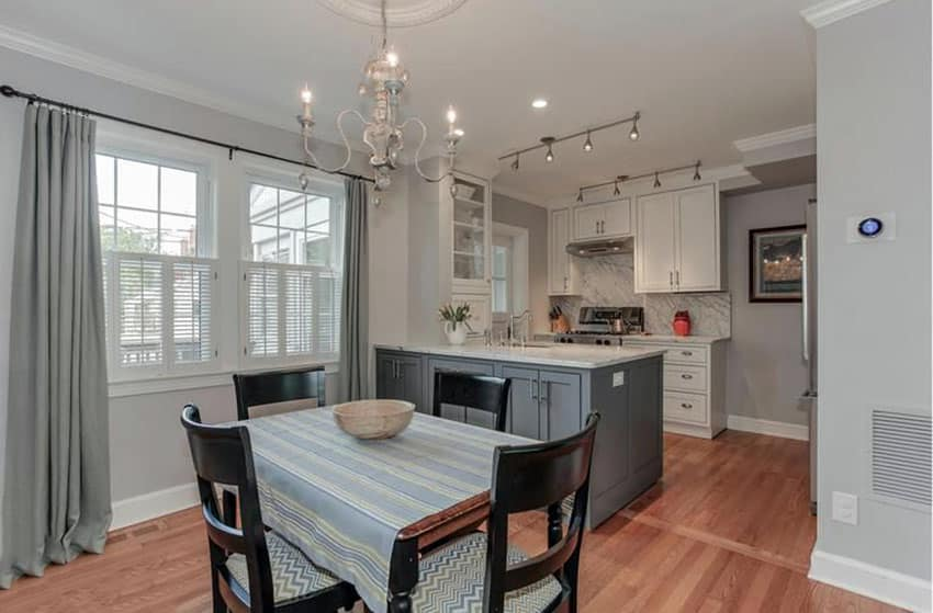 Small kitchen with gray cabinet peninsula and white main cabinets