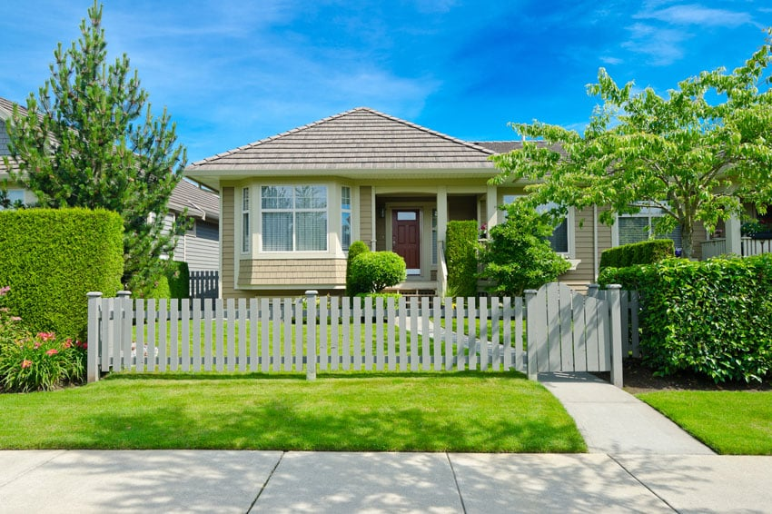 Small wooden fence in front of home