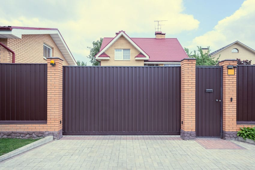 Solid iron fence with metal panels