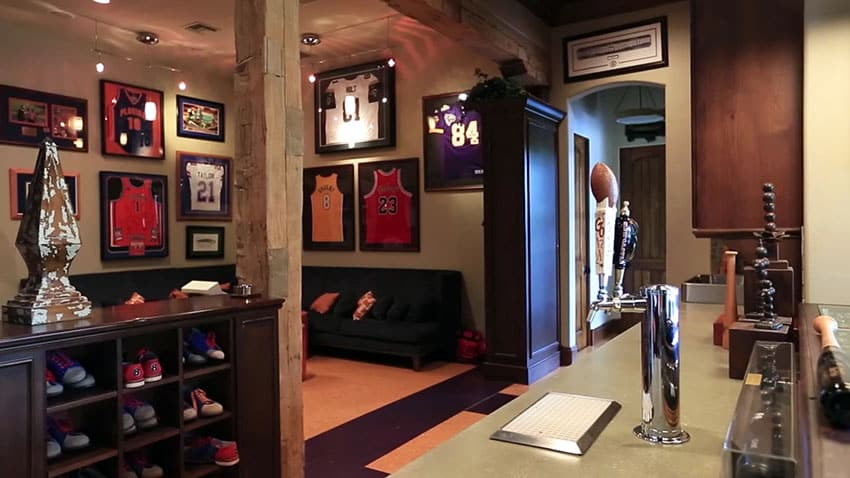 Sports man cave with team jerseys and beer tap