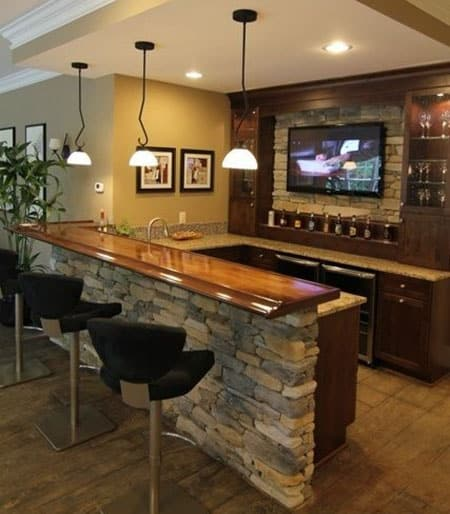Stacked stone home wet bar with u shaped layout