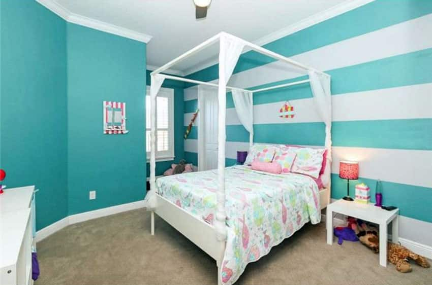 Teal and white striped wall bedroom design with four post bed