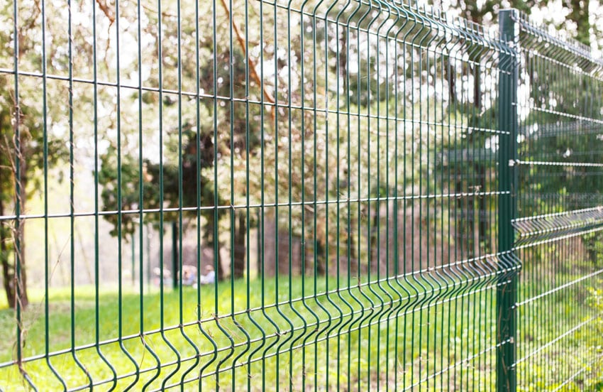 Thick green wire fence in garden