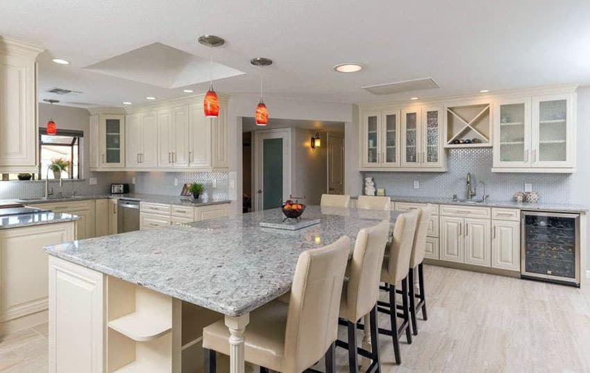 Traditional kitchen with andino white granite countertops, antique white cabinets and breakfast bar island
