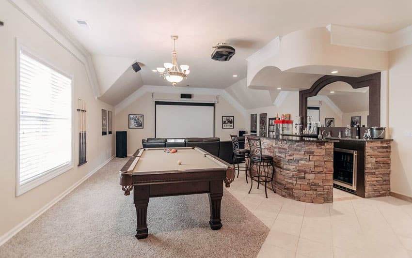Upstairs game room and home bar with stacked stone