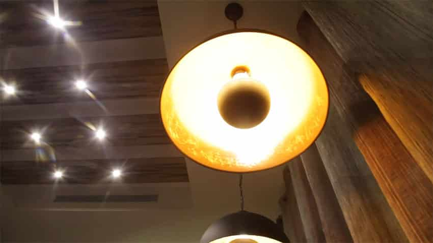 View of hanging lighting and recessed lights above dining table