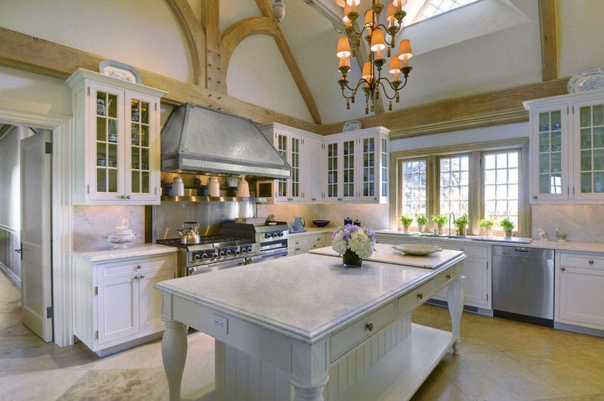 White cabinet cottage kitchen with marble counter island and high ceiling