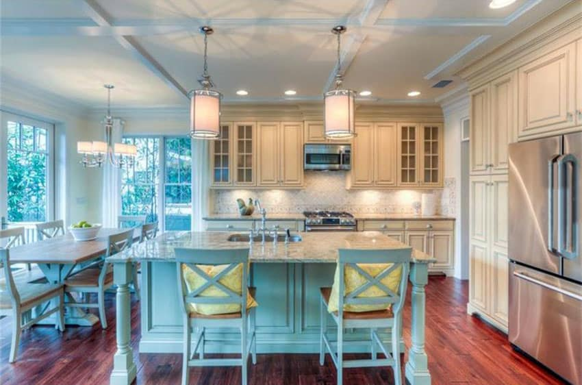 White kitchen with light blue island breakfast bar and box ceiling