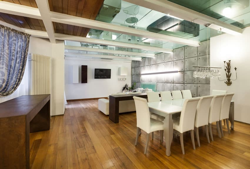 White modern dining room in loft building