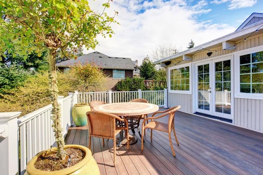 White fence around wood deck