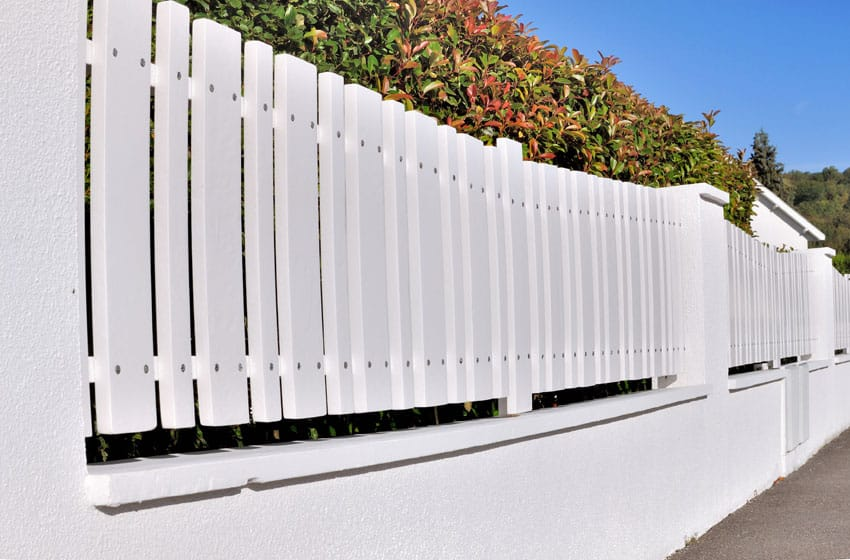 White pvc fence in yard