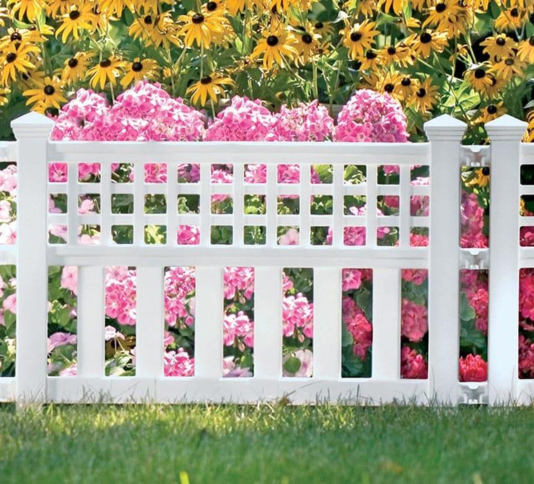 White resin fence in garden