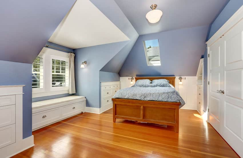 Window seat bench in bedroom with blue walls