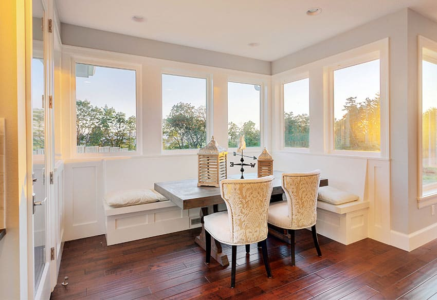 Window seat in dining room with white cushions