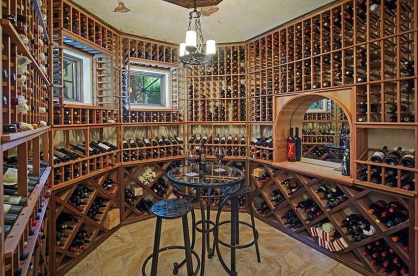 Large custom wood wine cellar with floor to ceiling bottle storage