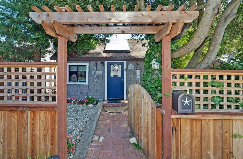 Wood fence with lattice and arbor gate