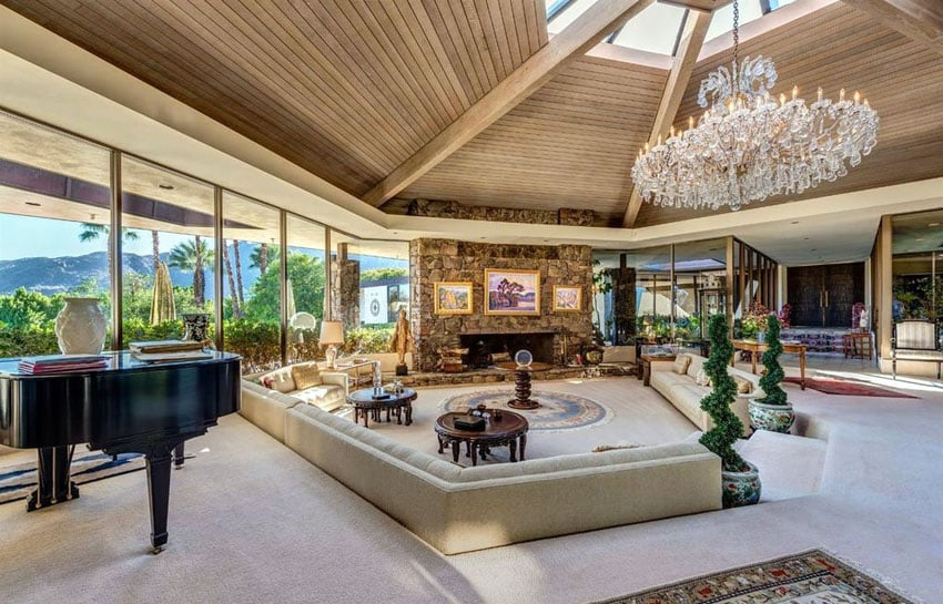 Beautiful sunken living room with large chandelier and vaulted ceiling
