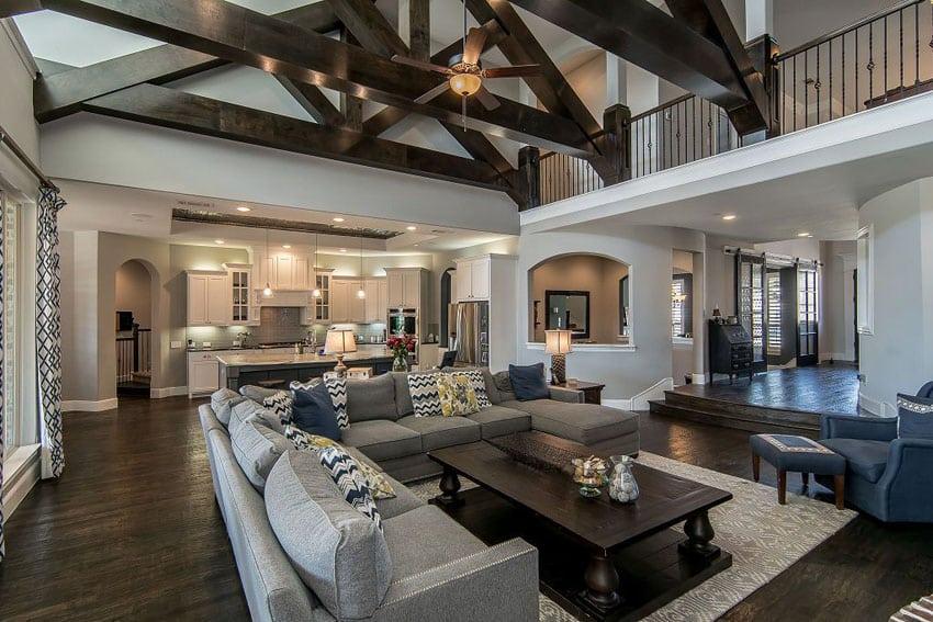 Beautiful sunken living room with vaulted ceiling and dark wood floors