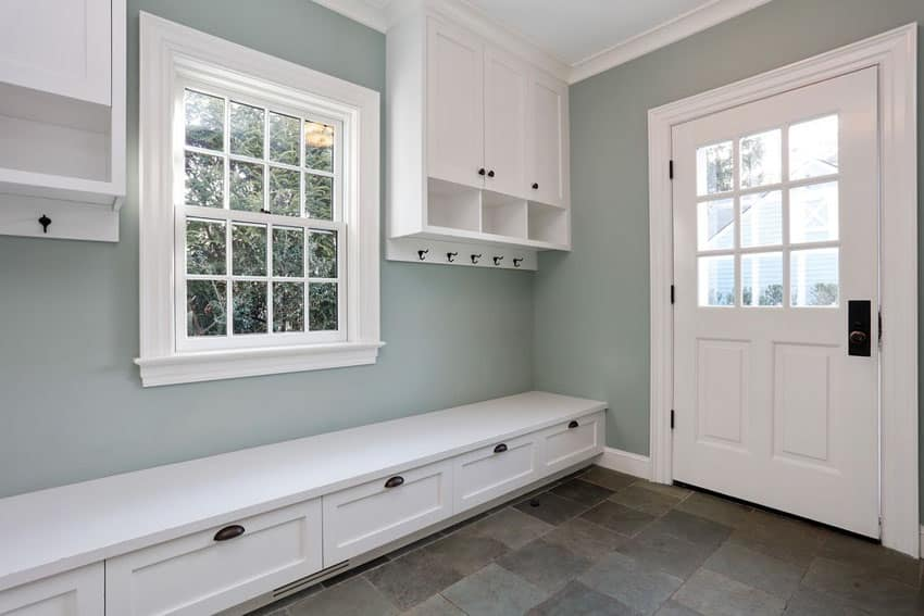 Beautiful white and gray mudroom with cabinet storage and bench