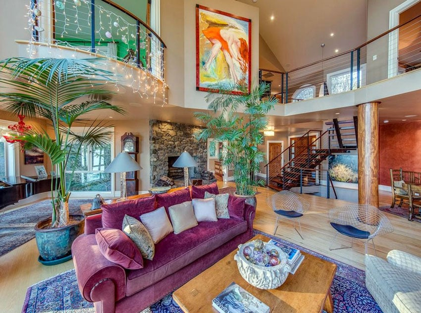 Colorfully decorated sunken living room with balcony