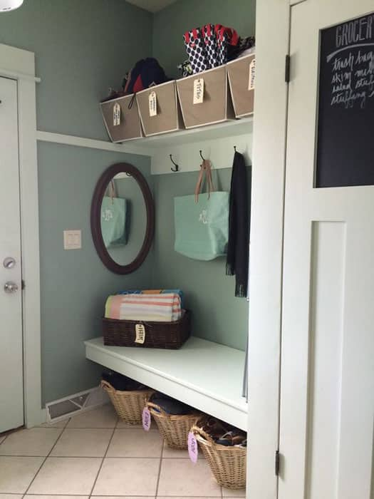Contemporary mud room with bench wicker laundry basket storage and coat hangers