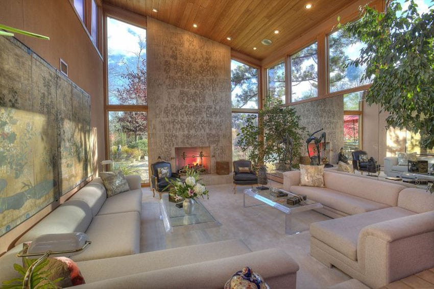 Contemporary sunken living room with high ceilings and fireplace