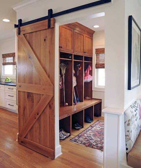 Country mud room with sliding barn door