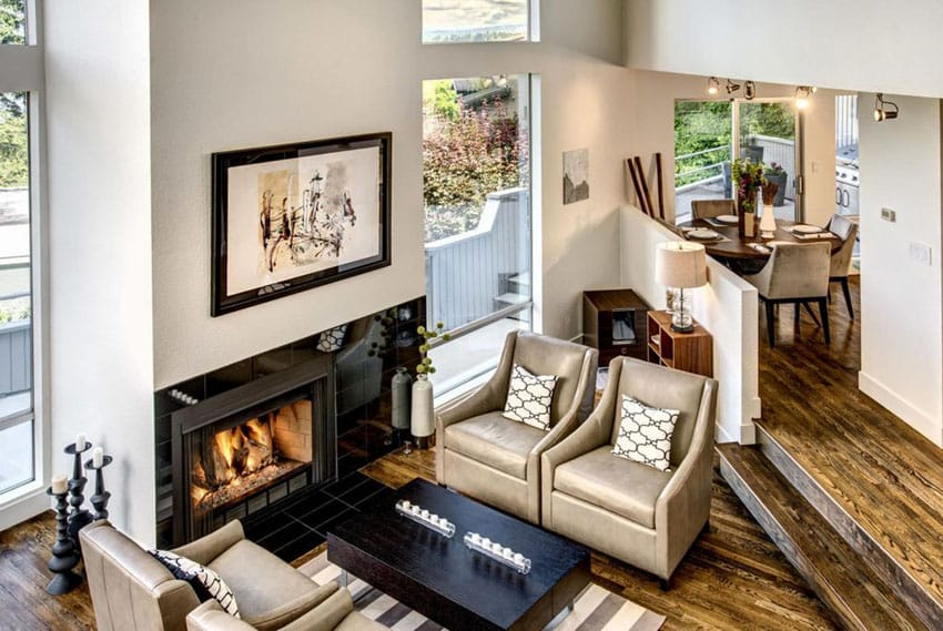 Cozy sunken living room with wood floors and fireplace