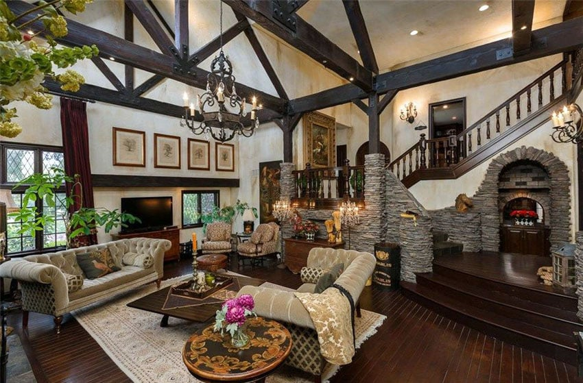 Craftsman living room with dark wood flooring, stone arches and trim