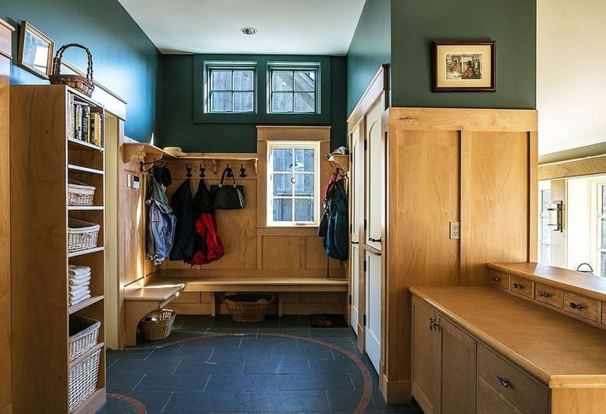 Craftsman mud room with storage cabinets, wood bench and closet