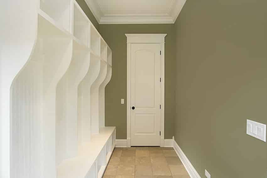 Green and white mudroom hallway