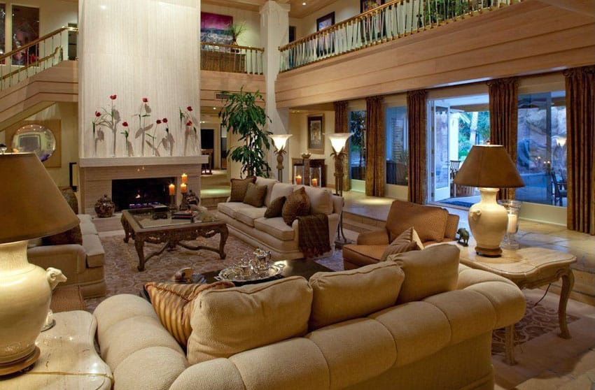 Luxury living room with sunken floors, fireplace and high ceilings