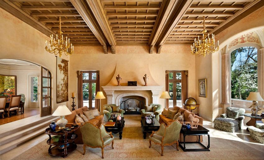 Mediterranean style sunken living room with decorative wood ceiling
