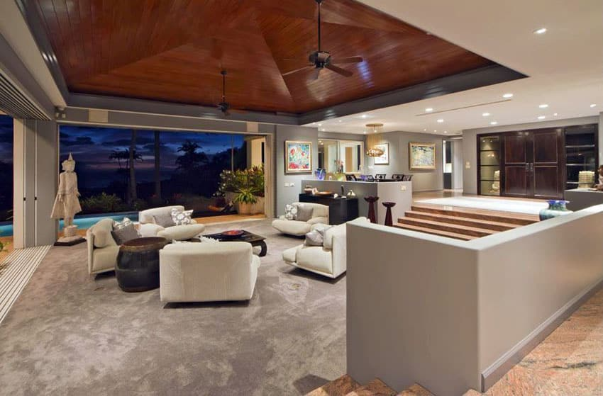 Modern sunken living room with open layout to backyard patio