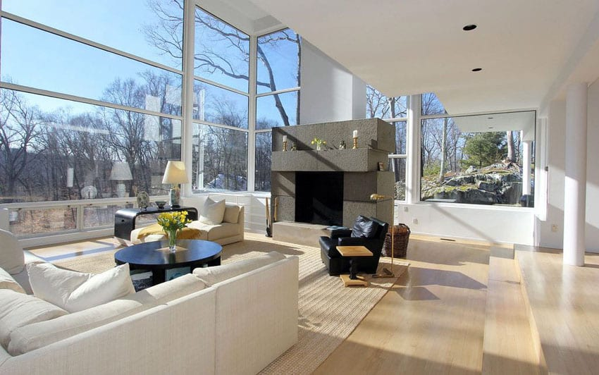 Modern sunken living room with white oak floors and fireplace