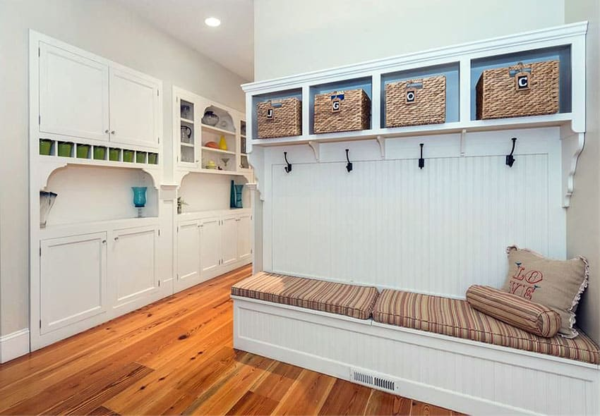 Mud room with bench seating and cubby shelving