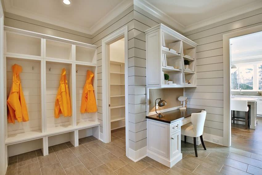 Mudroom with custom built in coat racks and bench seating