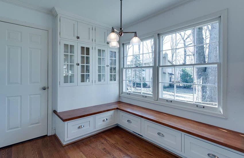Mudroom with window seat bench and storage cabinets