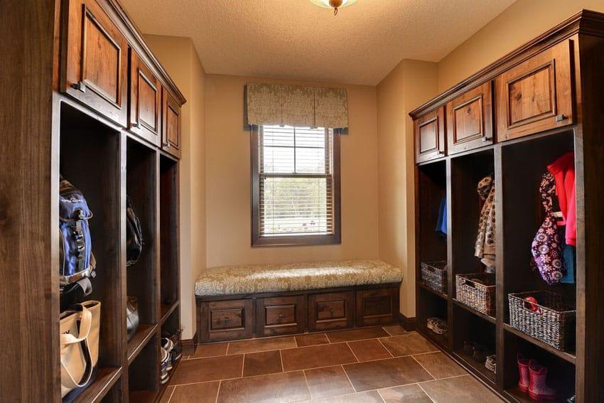 Mudroom with wood cabinetry bench and cubbies