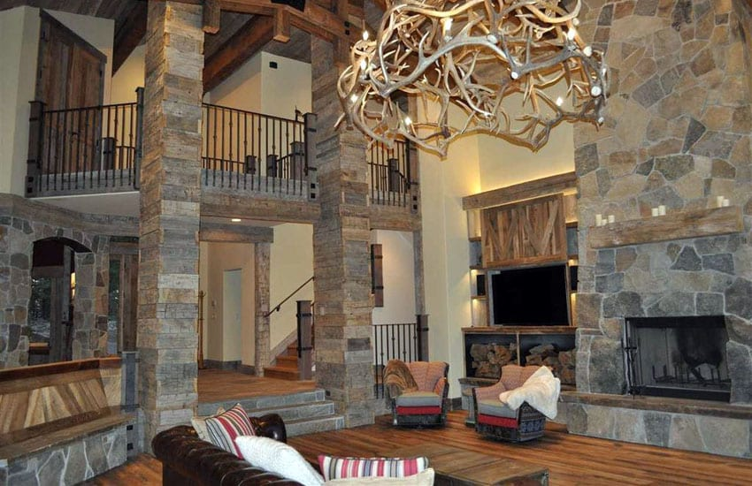 Rustic sunken living room with wood columns