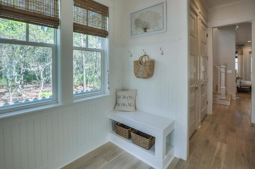 Small cottage mudroom bench and under seat cubbie storage