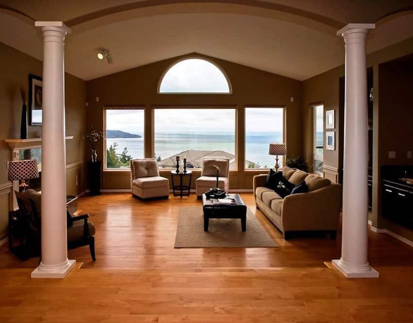 Sunken living room with light wood floors and amazing ocean views