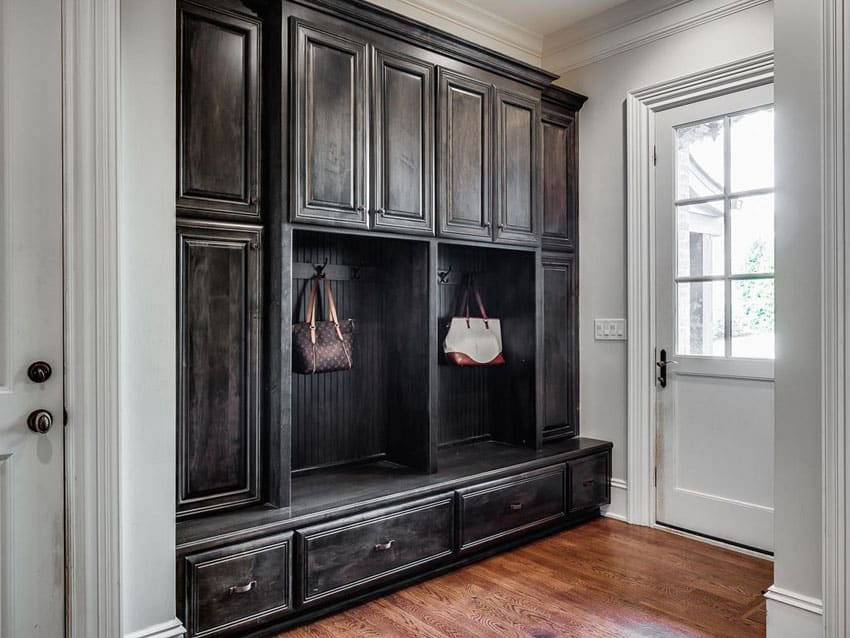 Traditional entryway mudroom with built in wood storage