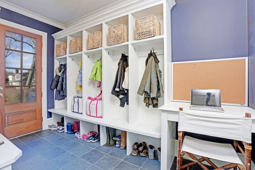 Traditional style mudroom with kids cubbies baskets and clothing hangers