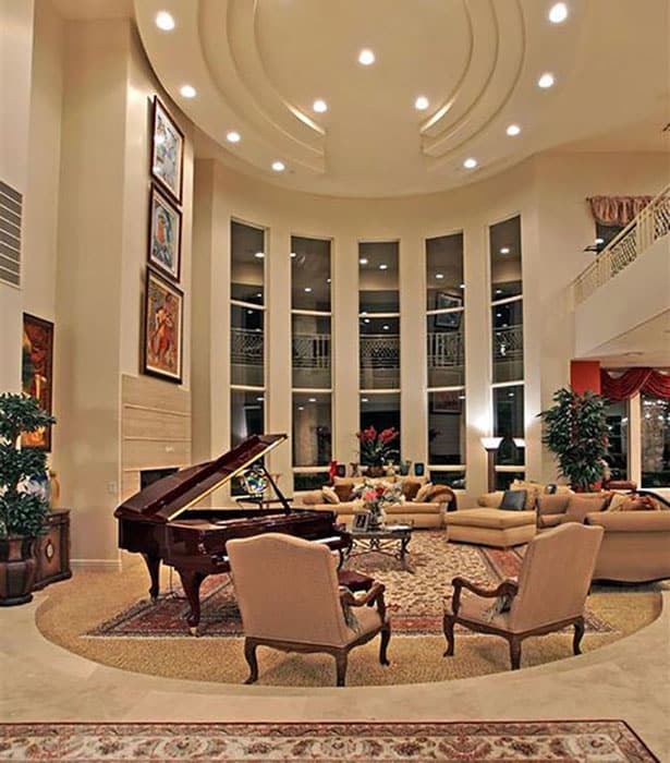 Traditional style round sunken living room with grand piano