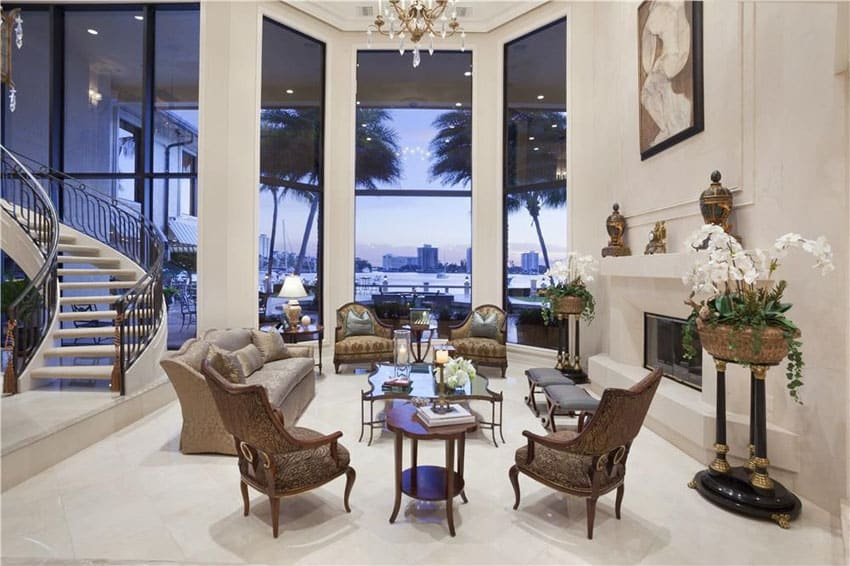 Traditional sunken living room with high ceiling water views and circular staircase