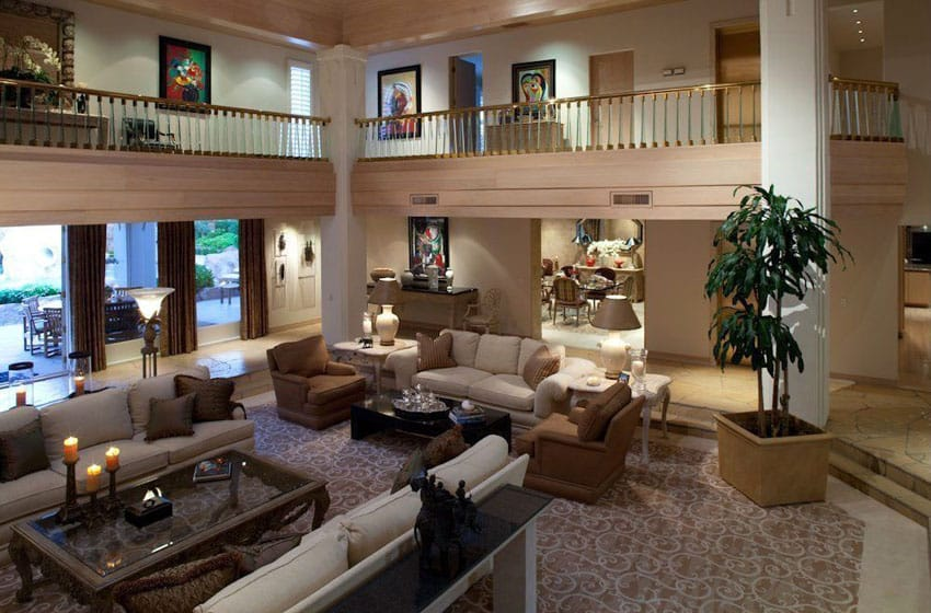 Traditional sunken living room with second story balcony